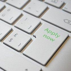 "a part of a keyboard written ""apply now"""