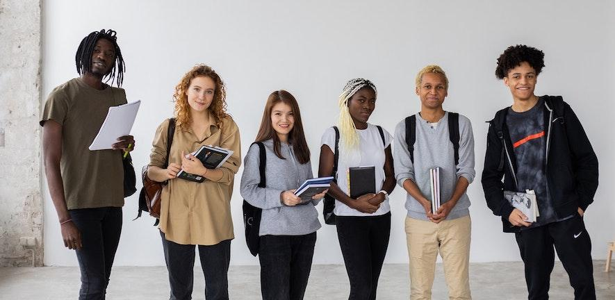 People holding books looking/posing to the camera